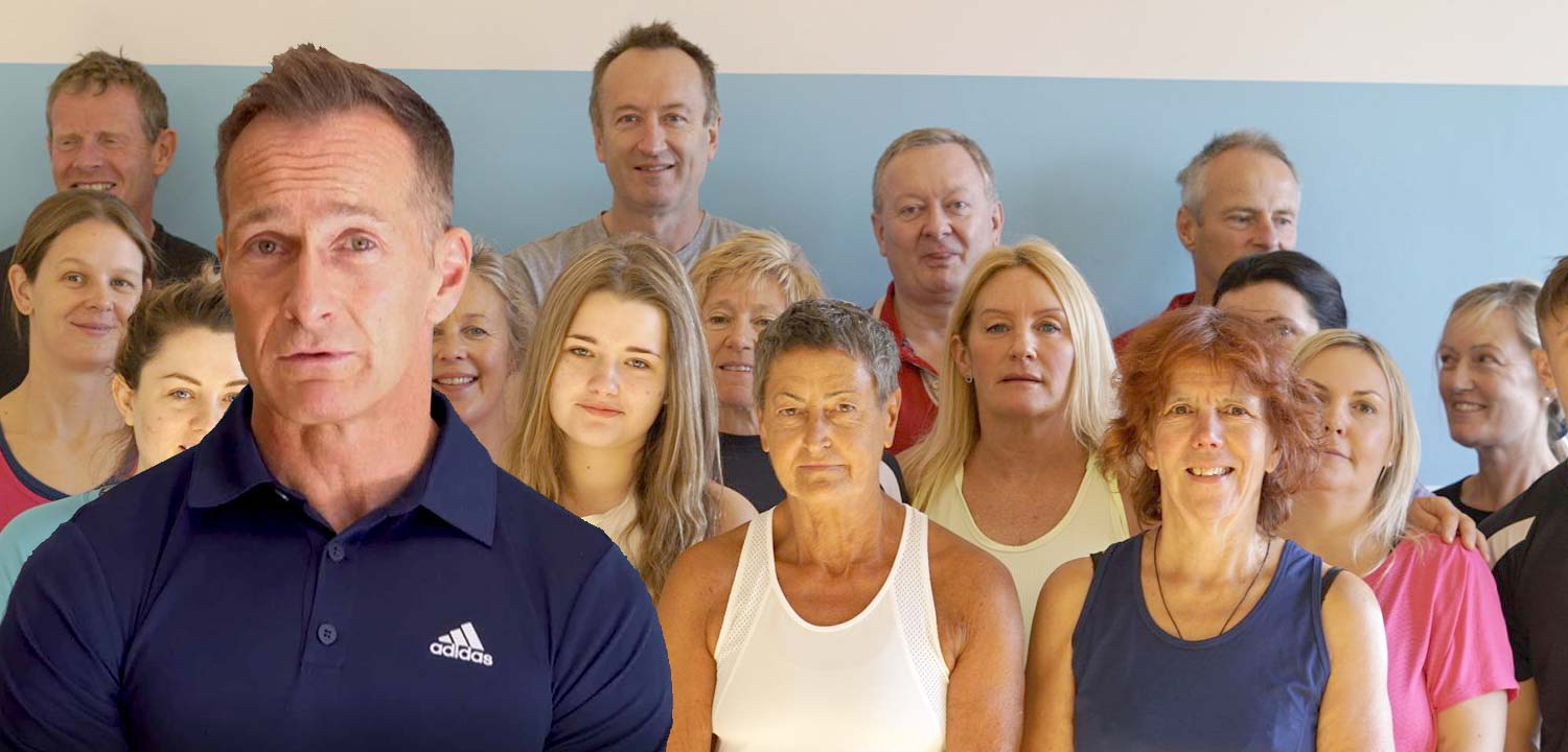 Andy with a group of people doing the health transformation programme